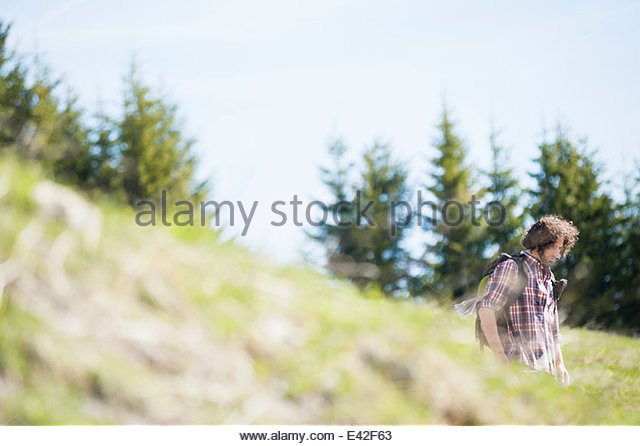 Mid adult man walking in Tegernsee, Bavaria, Germany - Stock-Bilder
