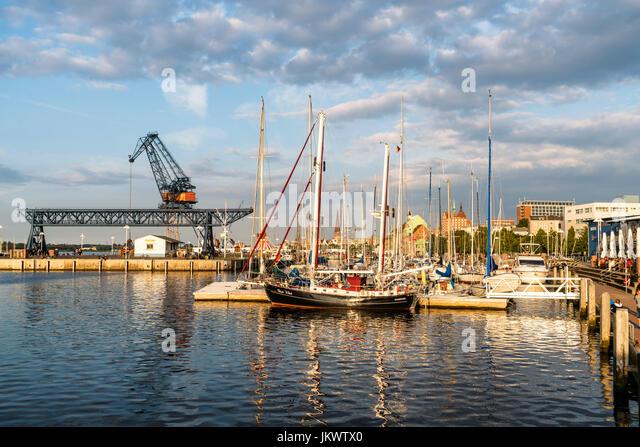 Port of Rostock , Sailing boats, harbor crans, Mecklenburg-Vorpommern, - Stock Image