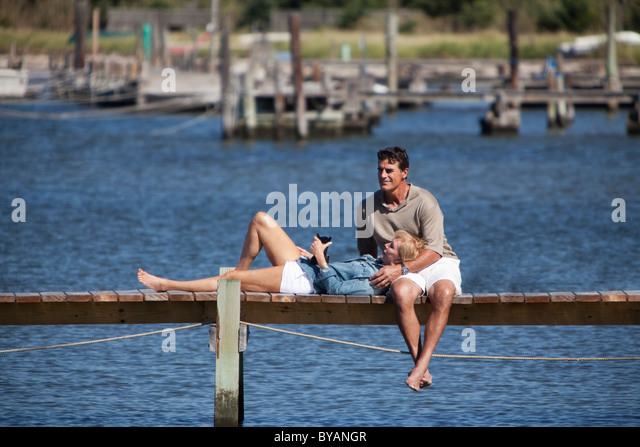 Couple together on dock - Stock Image