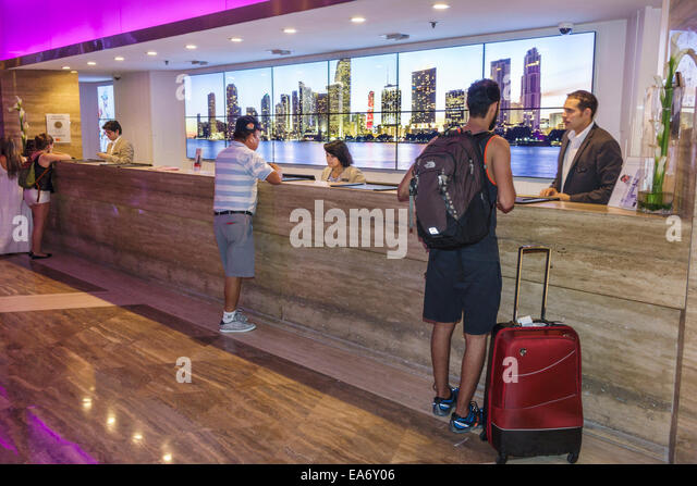 Miami Florida Intercontinental hotel lobby front desk reservations check-in guests - Stock Image