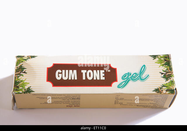 Ayurvedic ; toothpaste gum tone gel relief from gingivitis halitosis routine oral hygiene strengthen gums on white - Stock Image