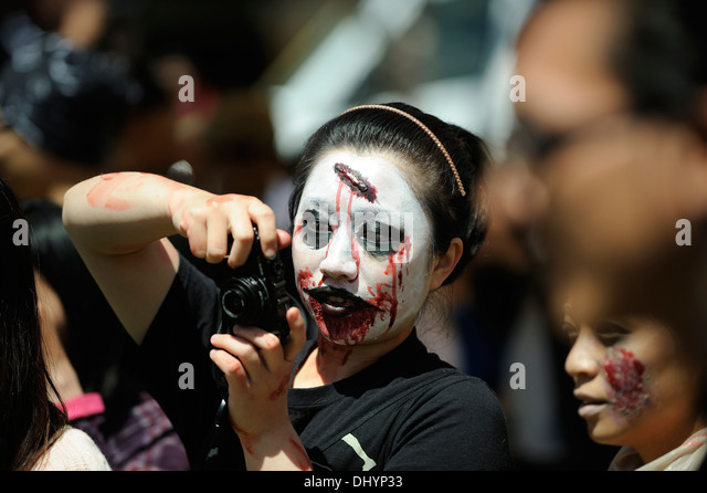 Zombie taking photographs in the inaugural Zombie Walk, Perth, Western Australia - Stock Image