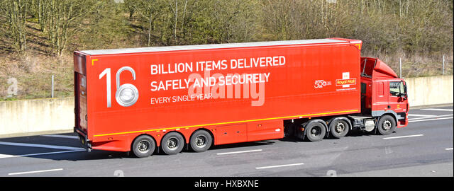 UK motorway Royal Mail lorry trailer promoting delivering billion parcels & billions of letters a year & - Stock Image