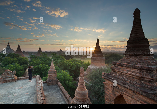 Wendy taking a picture of the Temples of Bagan at sunrise, Myanmar (Burma) - Stock Image
