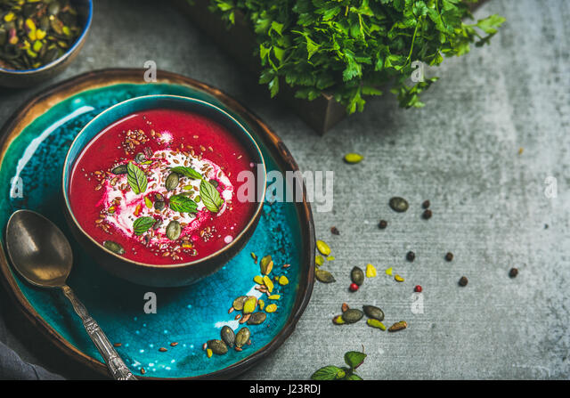 Spring beetroot soup with mint and seeds, copy space - Stock Image