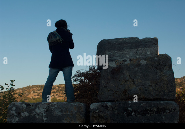 Photographer at work on the ruins of Ephesus, a Graeco-Roman City in Turkey. - Stock Image