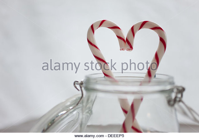 Close up of candy canes forming heart-shape - Stock-Bilder