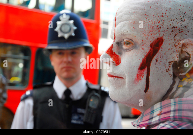 Policeman with zombie protester in Oxford Street, London, 29-04-2011.PHOTO © John Robertson, 2011. - Stock Image