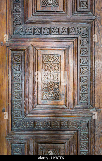 Ornaments of the wooden aged antique door at Madrasa and Mausoleum of As-Saleh Nagm Ad-Din Ayyub, Old Cairo, Egypt - Stock Image