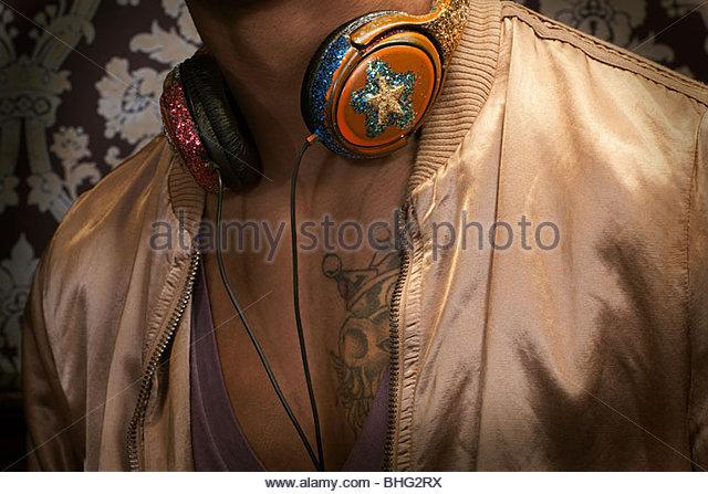 Close up of man with headphones around neck - Stock-Bilder