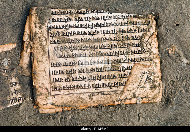 A holy book written in Sanskrit on the beach at Gangasagar, West Bengal. - Stock Image