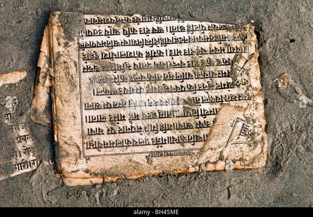 A holy book written in Sanskrit on the beach at Gangasagar, West Bengal. - Stock Image