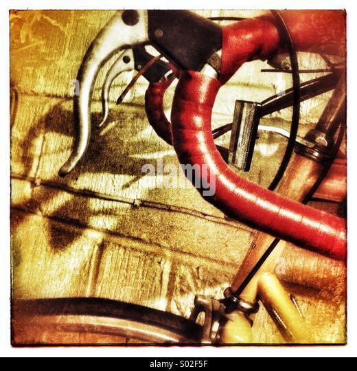 Sad Unused Bike on Garage Wall - Stock Image