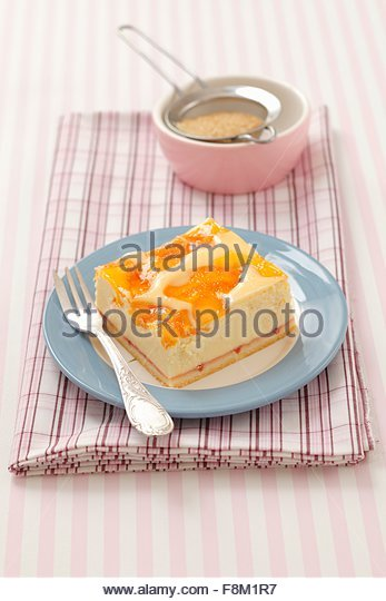 A slice of peach cheesecake - Stock Image