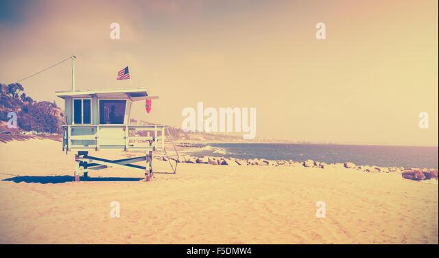 Old film retro stylized lifeguard tower, Santa Monica, USA. - Stock Image