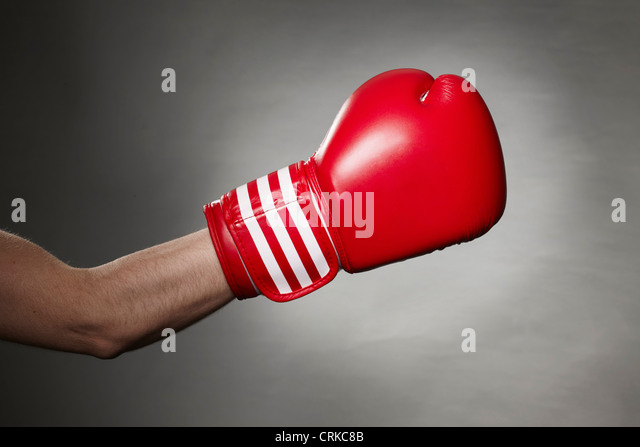 Hand wearing boxing glove - Stock Image