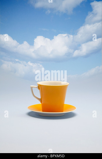 coffee cup floating on the clouds - Stock Image