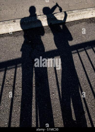 A caring couple shadows - Stock Image