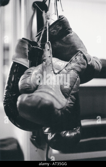 Boxing gloves hanging up - Stock Image