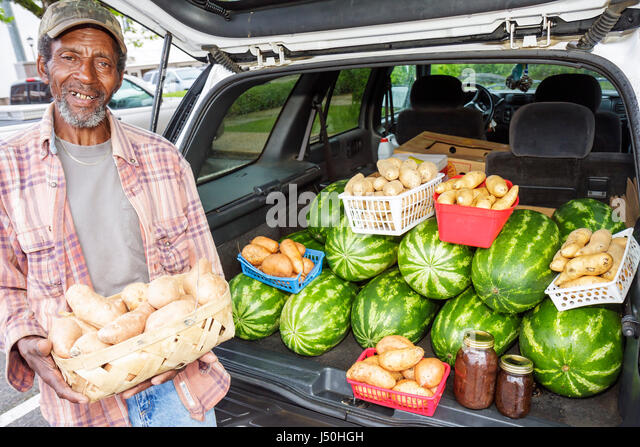 Alabama Camden Courthouse Square Black man senior vendor produce fruit food agriculture farming nutrition watermelons - Stock Image