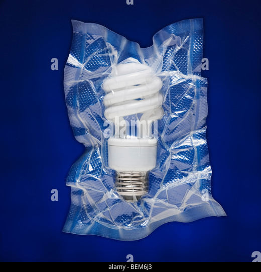 Shrink wrapped light bulb - Stock Image