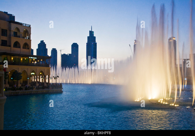 The spectacular Dubai Fountain display in front of the Souk al Bahar in downtown Dubai, UAE - Stock Image