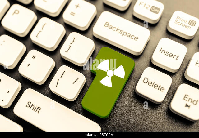 Keyboard with radioactive green button. Concept image. - Stock Image
