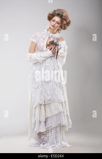 Finery. Glamorous Lady in Elegant Lacy Dress - Stock Image