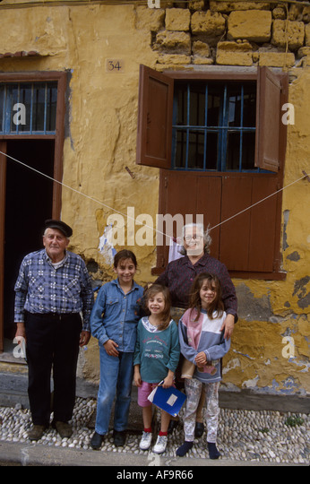 Greece Isle of Rhodes Old Town medieval district residents grandparents children - Stock Image