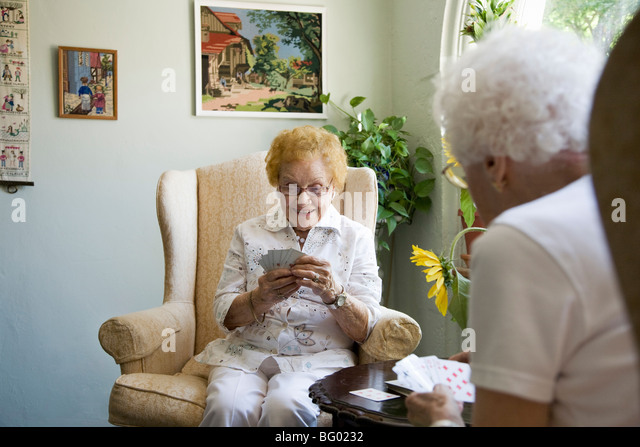 Mature ladies playing cards together - Stock Image