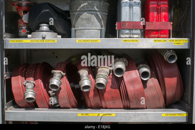 Fire hoses and other fire fighting equipment on board a fire engine or truck England, UK - Stock Image
