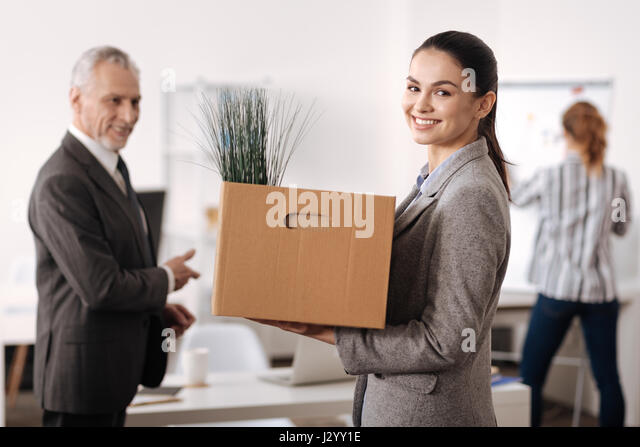 Portrait of happy girl while starting working at firma - Stock Image