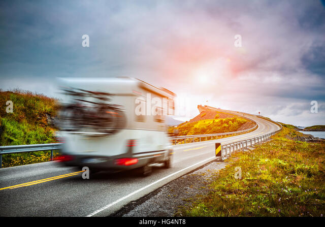 Caravan car travels on the highway. Caravan Car in motion blur. Norway. Atlantic Ocean Road or the Atlantic Road - Stock Image