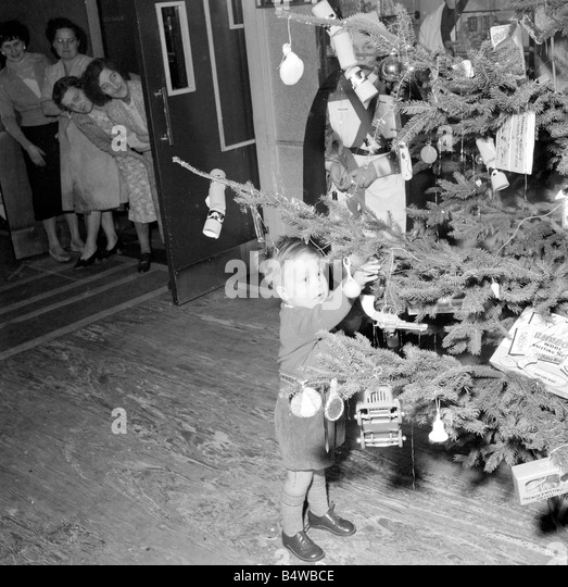 Young master John Masterson inspects the christmas tree and its decorations at a West London hospital December 1954 - Stock Image