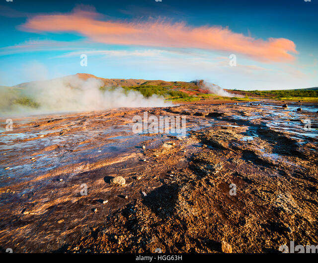 Sunny summer morning in Great Geyser valley, on the slopes of Laugarfjall hill. Colorful exotic scene in Southwestern - Stock Image