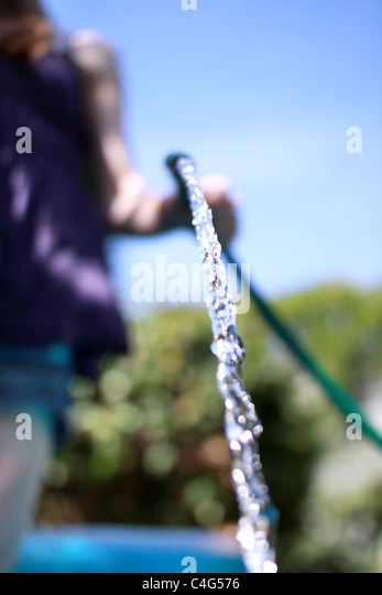 girl with a hose pipe - Stock-Bilder