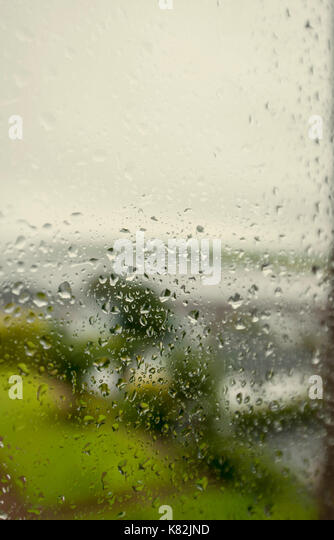 Detail of raindrops on a window - Stock Image