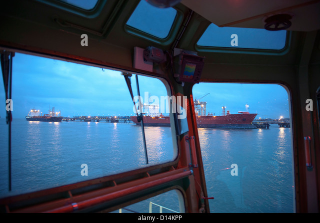 Tanker ships as seen from tugboat - Stock Image