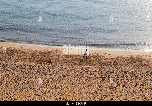Jogger at the beach, Beirut, Lebanon - Stock Image
