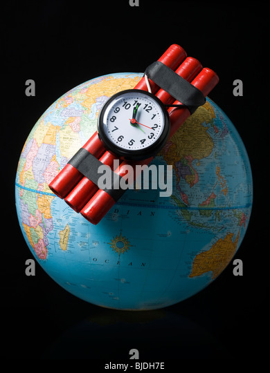 globe with dynamite attached - Stock Image