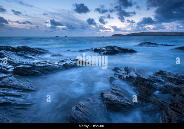 Twilight over Trevose Head from the rocky shores of Treyarnon Point, Cornwall, England. Summer (August) 2013. - Stock Image