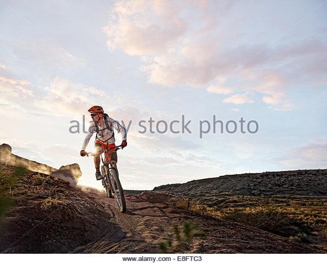 USA, Colorado, Mesa County, Grand Junction, Mountain Biker on route - Stock Image