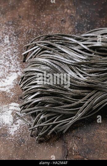 Raw black spaghetti pasta - Stock Image