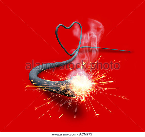 Lit fuse in a heart shape - Stock Image