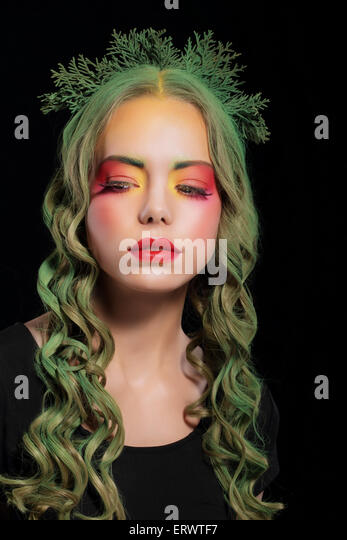 Stylish Woman with Dyed Hairs and Extravagant Makeup - Stock Image