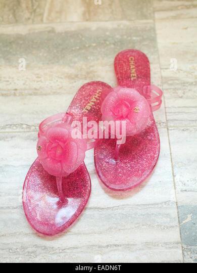 Pink Flip Flops on marble floor, Miami Beach, Florida - Stock Image