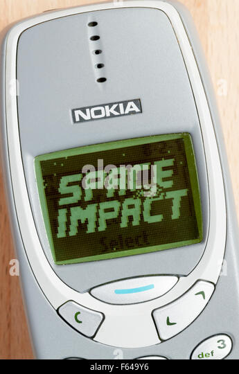 The title screen of the cult Space Impact game on a Nokia 3310 mobile 'phone. - Stock Image