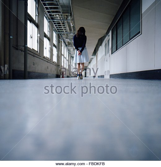 Surface Level Of Woman Standing In Corridor - Stock Image