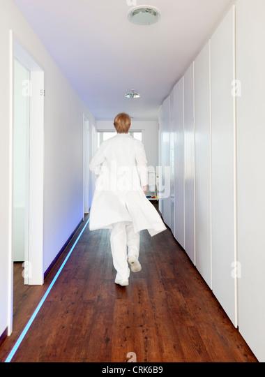 Doctor walking in hallway - Stock Image