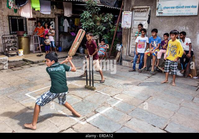 Mumbai India Asian Lower Parel old apartment building hanging laundry courtyard boy friends playing Hari Baug Box - Stock Image